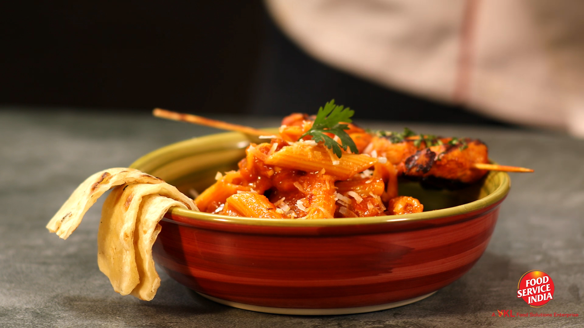 Smoked Chipotle Tikka on the Bed Of Spicy Penne Arrabiata With Garlic Naan