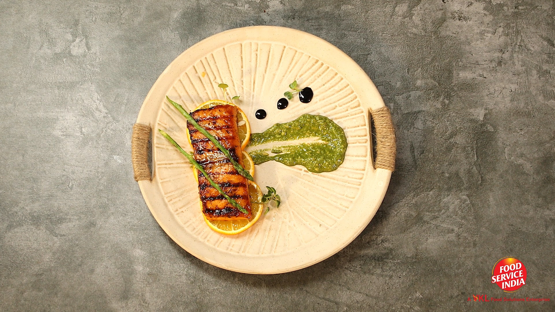 Cajun Spiced Grilled Salmon Served With Basil Pesto Sauce